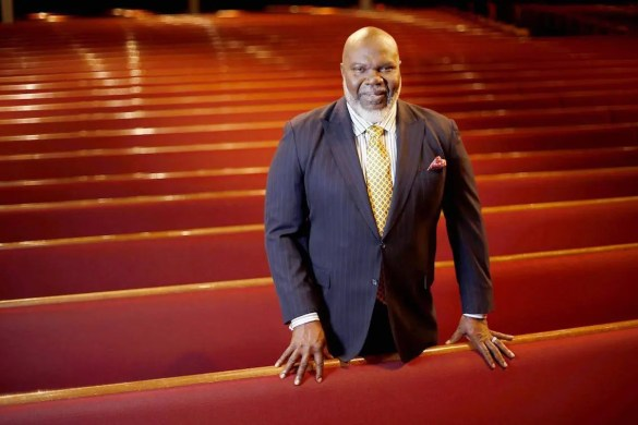 T.D. Jakes is seen in the pews of a church.