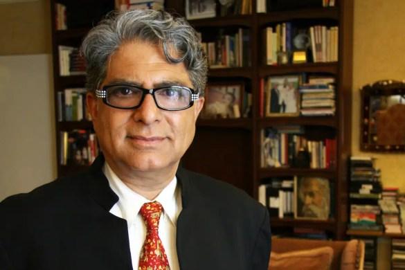 Deepak Chopra is shown with a bookshelf in the background.