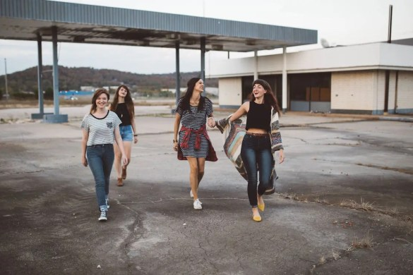 A group of 4 young women walk together. They share similar style which shows how we influence each other. It is important for you to continuously evaluate your associations.