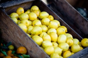 There are numerous health benefits of lemons that make it a key fruit to add to your diet. A basket of lemons is show.