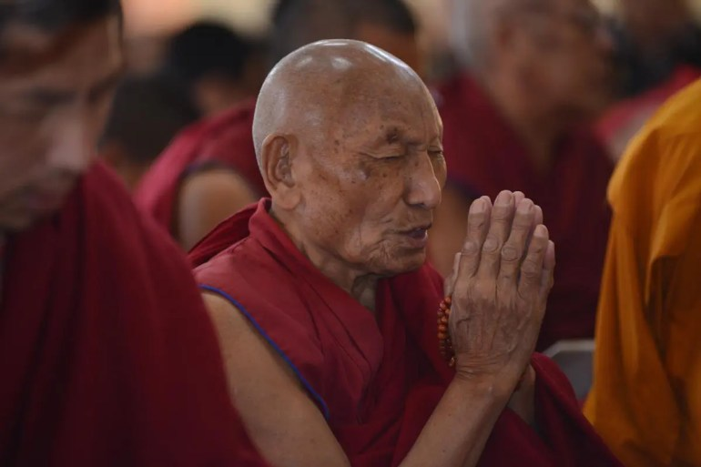 Tibetan Buddhist Monk Palden Gyatso is seen praying.