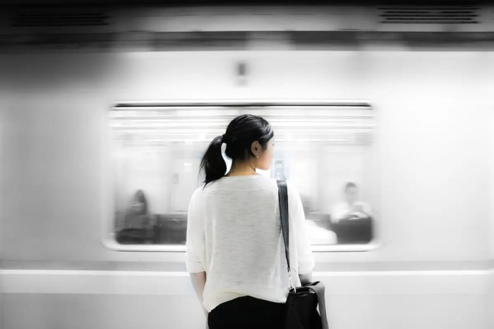 A woman is shown in a subway looking around anxiously. She is suffering from an anxiety disorder.