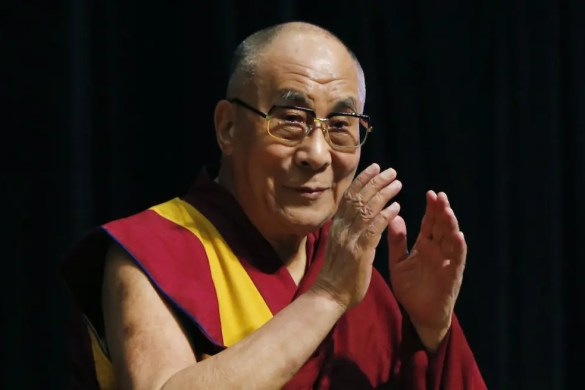 Tibetan spiritual leader the Dalai Lama greets an audience before his religious speech in Tokyo, Monday, Nov. 25, 2013.