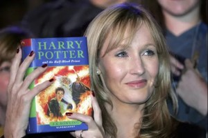 J.K. Rowlings, the author of the Harry Potter book series, is shown holding one of her books. She is one of the famous failures that we explore in this article.
