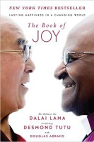 The cover for The Book of Joy: Lasting Happiness in a Changing World is shown. It ranks third on Balanced Achievement's list of the top 10 self-help books of 2016.