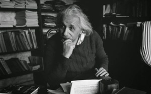 A picture of Albert Einstein is shown as he sits pondering in his Princeton University office.