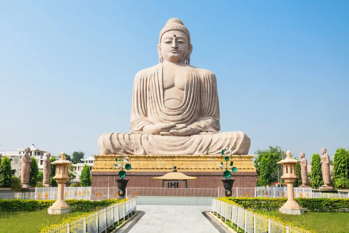 The Great Buddha Statue near the Mahabodhi Temple in Bodh Gaya is shown. The statue is 80 feet tall and acts as a monument for the Buddhists most important pilgrimage site.