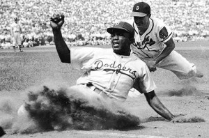 An image shows Jackie Robinson sliding into home plate.