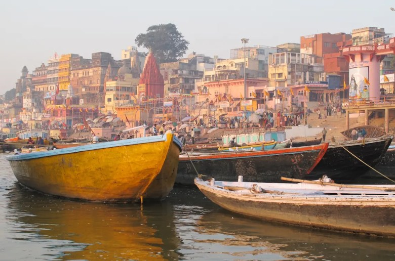 An image shown boats in the Ganges and the famous steps of Varanasi. This image is the featured image for Balanced Achievement's article on the sacred cities of India.