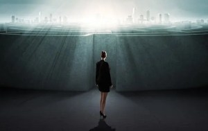 A computer generated image woman dressed in a business suit is seen looking at a massive and complex maze with achievement on the other side.