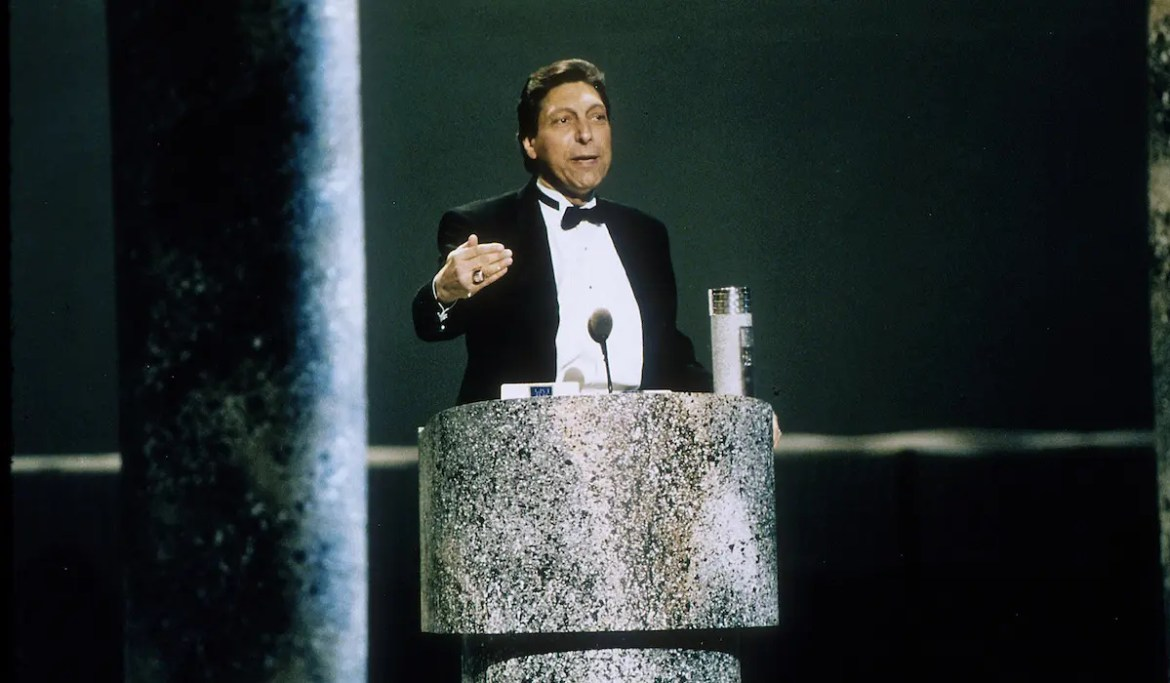 An image shows the late great basketball coach Jimmy Valvano delivering his acceptance speech at the 1993 ESPY Awards. This picture serves as the featured image for Balanced Achievement's article on iconic inspirational speeches.