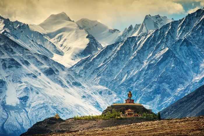 An image shows part of the Disket Moastery in Ladakh India. The stunning Himalayan backdrop make this one of Buddhists most notable religious communities in India.
