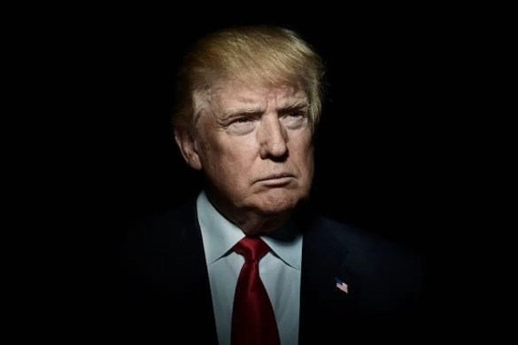 An image shows Donald Trump looking into the distance against a black backdrop. This picture serves as the featured image for Balanced Achievement's article on the psychology of Donald Trump.