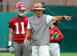 An image shows University of Alabama football coach Nick Saban has he coaches in practice. Nick Saban's process is built upon daily focus with little regard for outcomes.