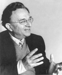 An image shows German psychologist Erich Fromm in conversation.