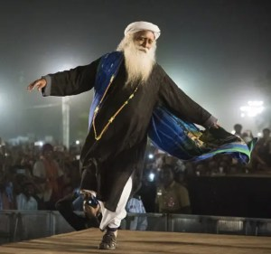 An image shows the great Hindu sage Jaggi Vasudev dancing exuberantly at the 2017 Mahashivratri festival.