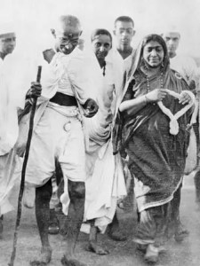 An image shows civil rights activist Mahatma Gandhi while on his famous Salt Walk. This picture, and Gandhi himself, are discussed in Balanced Achievement's article on integrity and intelligent effort.