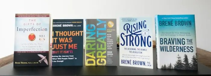 An image shows 5 acclaimed books of self-help author Brene Brown neatly displayed on a table.