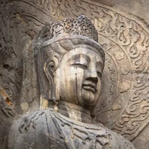 An image shows an ancient statue of the Buddha.
