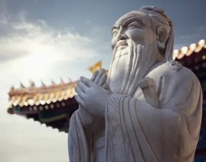 An image shows an ancient statue of the great Chinese philosopher Confucius.