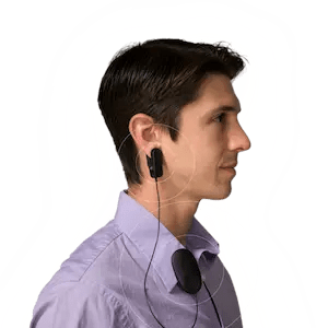 An image shows a man wearing Heartmath's Inner Balance Trainer device which is featured in Balanced Achievement's article on meditation tools of the digital age.