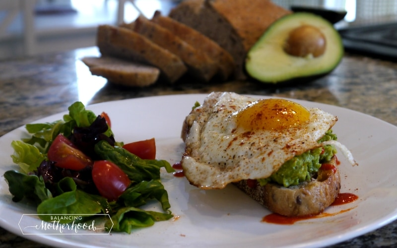 Avocado toast with egg and a side salad