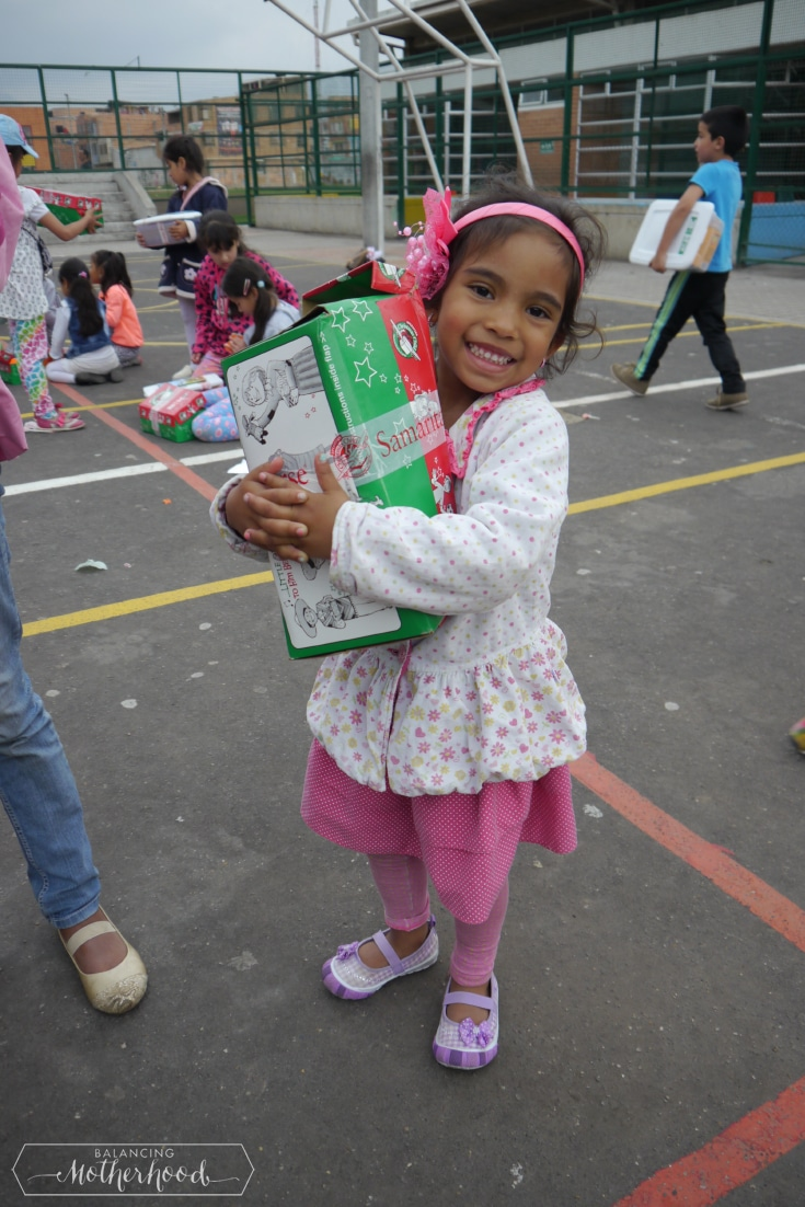 Little girl hugging her gift