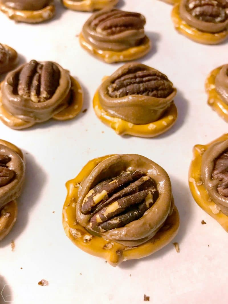 pretzels with melted Rolo candies and pecans