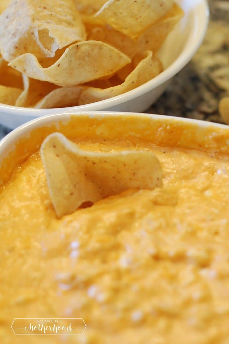 buffalo chicken dip with chips in white bowls
