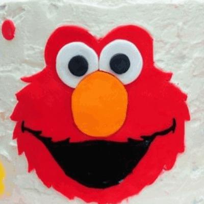 Elmo Cake With a Rainbow Cake Surprise Inside