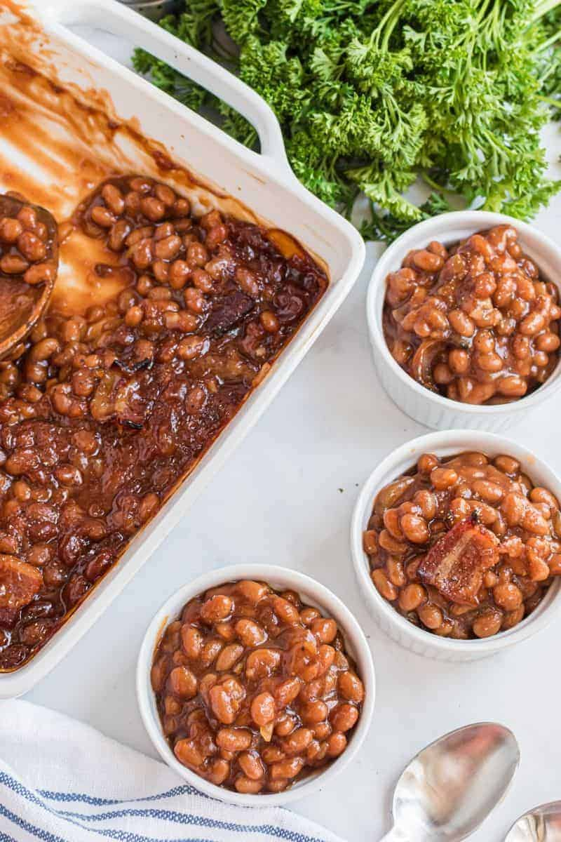 casserole dish with servings of baked beans next to it
