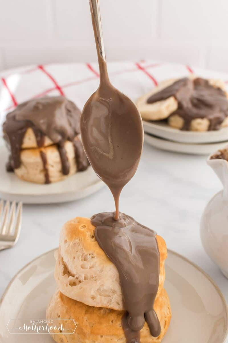 biscuits with chocolate gravy being drizzled on top