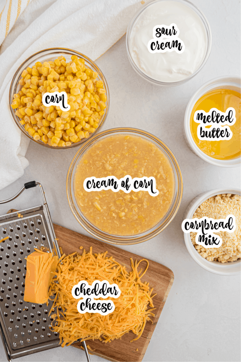 corn, cream of corn, sour cream, melted butter, cornbread mix, and cheddar cheese