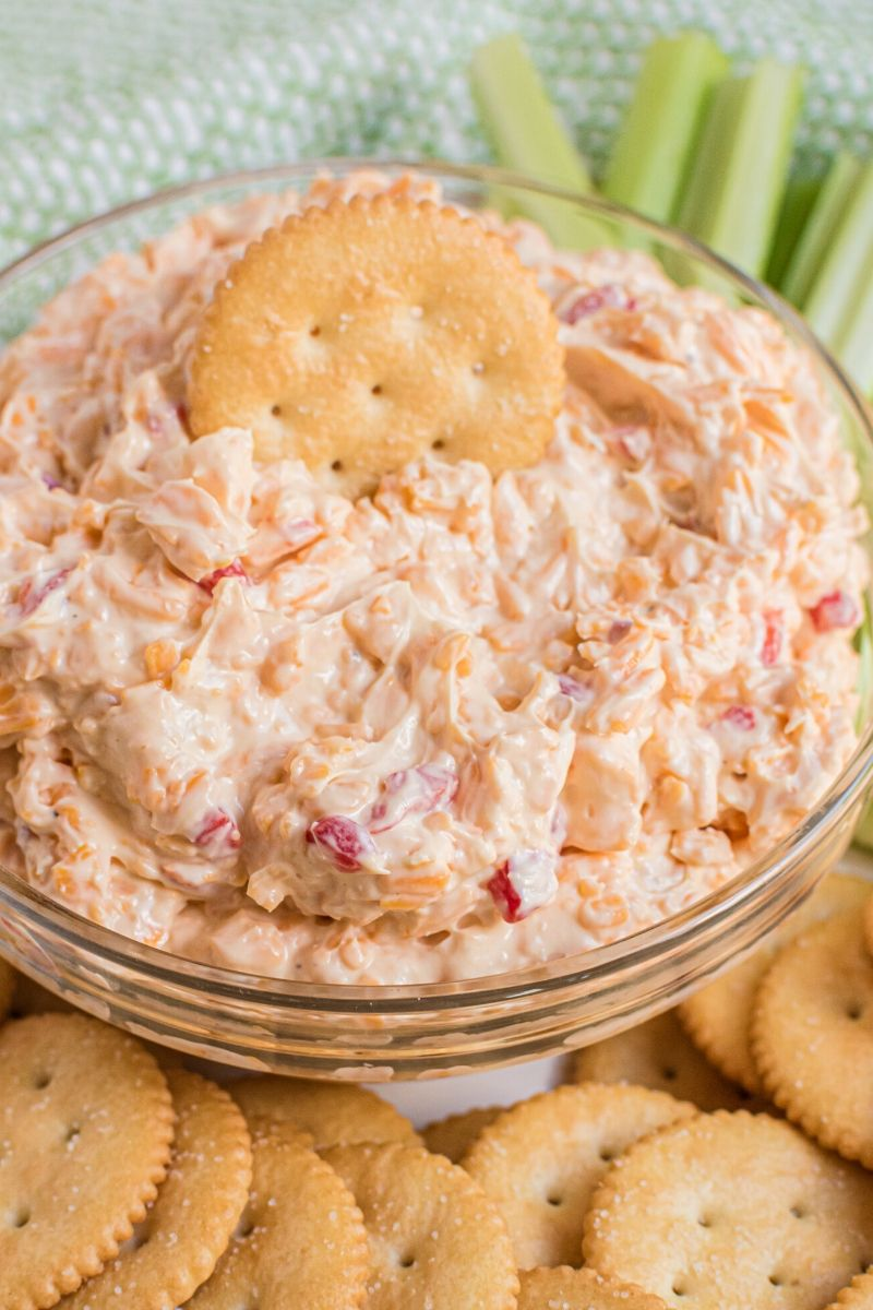 pimento cheese in bowl with Ritz cracker and celery