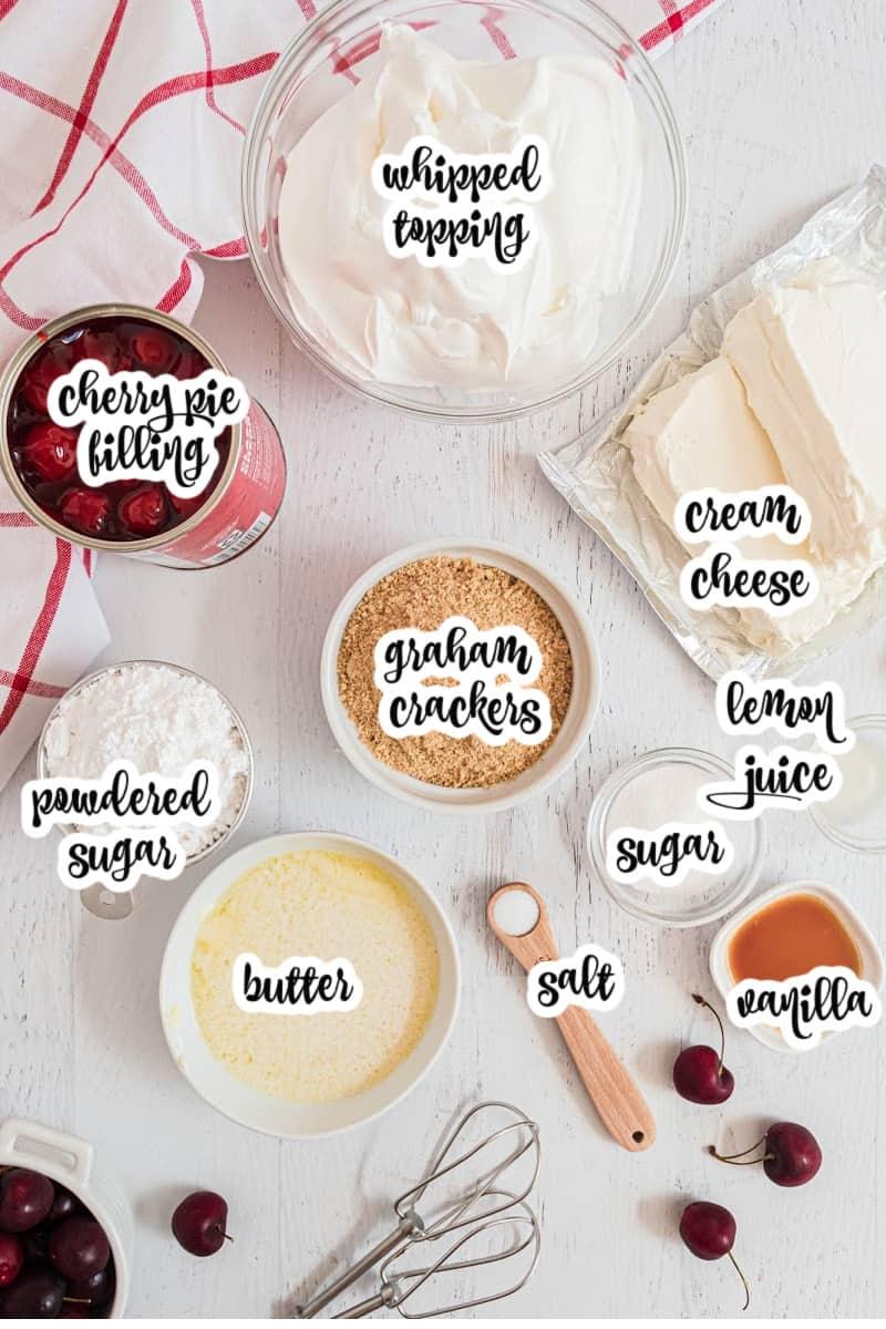 cherry cheesecake ingredients: cherry pie filling, whipped topping, cream cheese, lemon juice, sugar, graham crackers, vanilla, salt, butter, powdered sugar