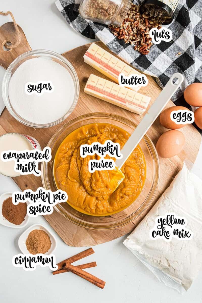 ingredients: sugar, nuts, butter, eggs, pumpkin puree, cinnamon, pumpkin pie spice, yellow cake mix, and evaporated milk