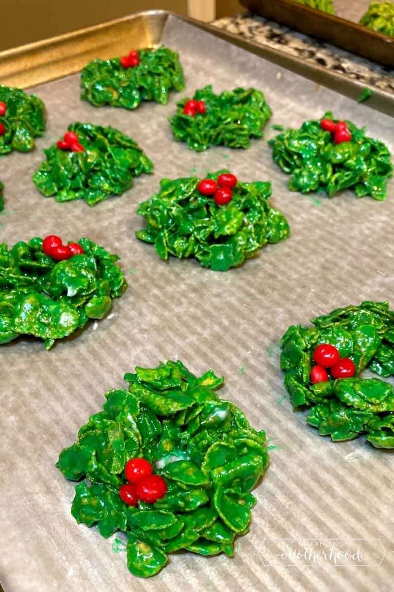 Rows of Christmas cornflake cookies with red hots.