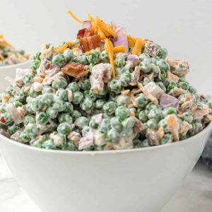 white bowl with pea salad