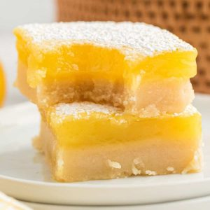 two lemon bars stacked, top one has a bit out