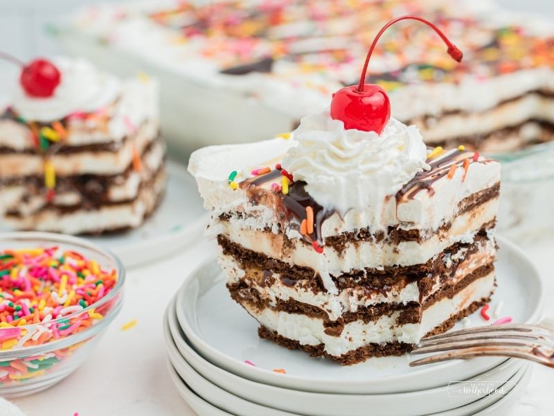 slice of ice cream sandwich sandwich cake with whipped cream and a cherry