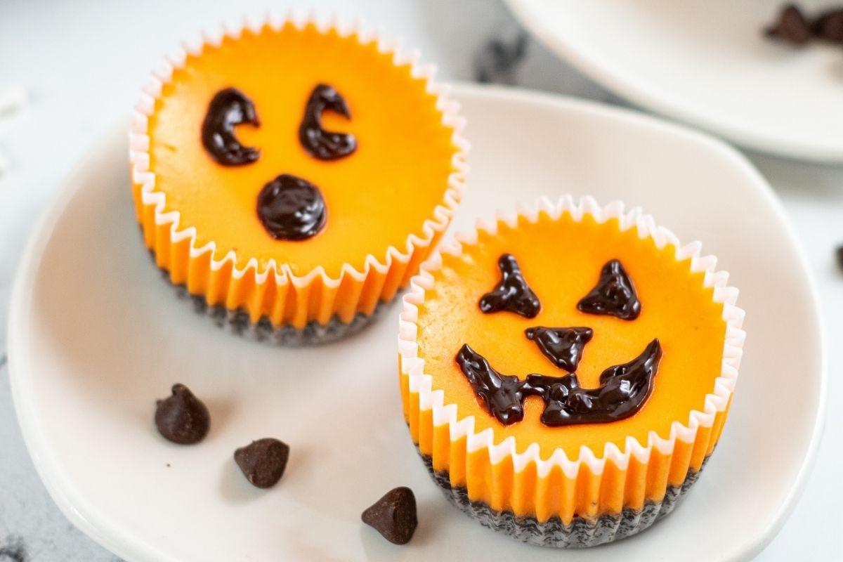2 orange pumpkin cheesecakes in cupcake wrapper