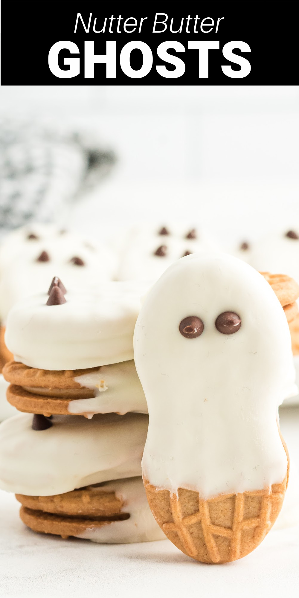 Nutter Butter Ghosts are a simple treat to make with Nutter Butters and chocolate that are perfect for Halloween.