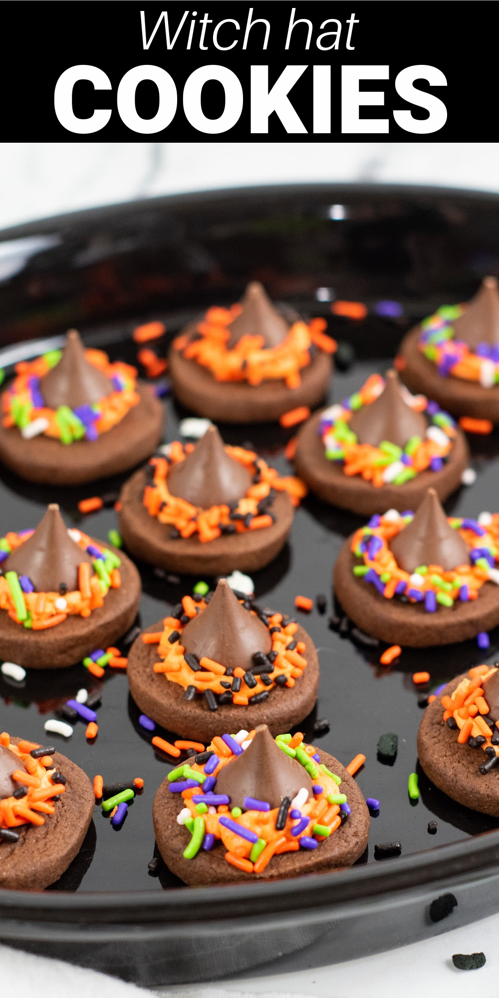 Witch hat cookies are a simple and fun treat that's perfect for Halloween. The base is a chocolate cookie topped with a creamy homemade buttercream frosting and a Hershey's kiss.