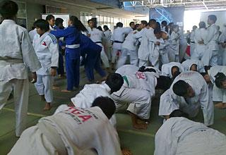 Judokas perform warmup before the tournament.