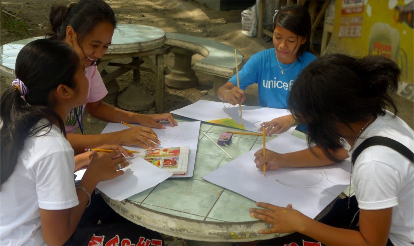 High School Students in Aleosan paint their visions of peace.