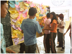 Students of Aleosan National High School and Pagangan High School post their ideas on how to build a culture of peace.