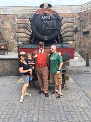 Islands of Adventure Hogsmeade with train conductor