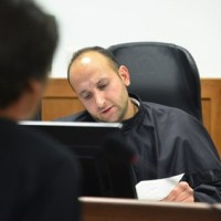 Докато съдия Николай Урумов решава дела в полза на община Приморско, неговата дъщеря получава имот на първа линия в града.