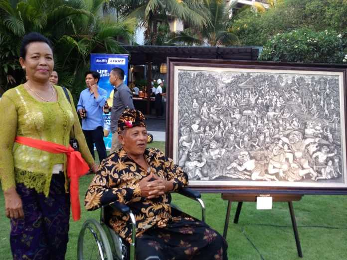 Dewa Putu Arsania with his wife showed one of his Batuan paintings on the exhibition at Pullman Hotels and REsorts, Legian, Kuta.