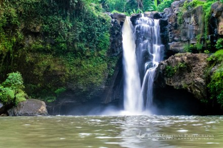 Bali, Gianyar, Tegenungan Waterfall. You can swim in the pool in front of the waterfall, the water is supposed to have magical powers.